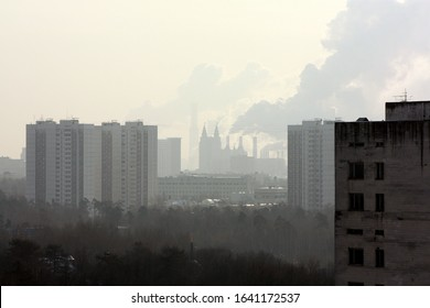 Moscow buildings skyline in the morning mist of a cloudy winter day. Smoke coming out of heating plant in the diastance. Towers of apartments rising above a park - Shutterstock ID 1641172537