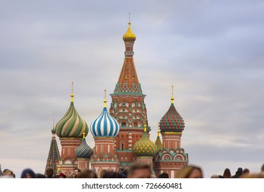 Moscow, The Cathedral of Vasily the Blessed and tourists at Red square in Russia
