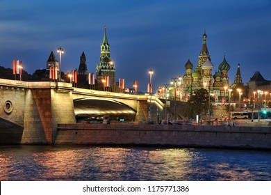 Moscow celebrates 871st anniversary on Sept 08, 2018. View from Raushskaya embankment on Bolshoy Moskvoretsky Bridge decorated with holiday banners, St. Basil's Cathedral & Spasskaya Tower in twilight
