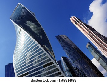 Moscow City. Bottom close-up view of futuristic modern skyscrapers of glass and metal of Moscow International Business Center.