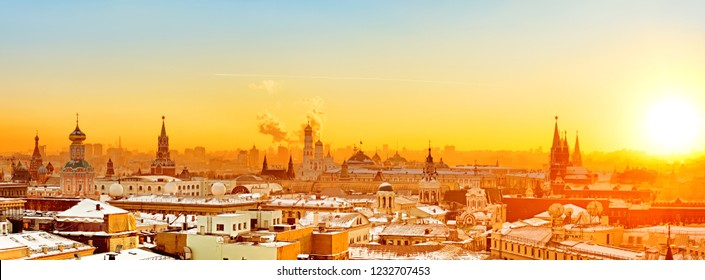 Moscow city historical skyline panorama winter snow building street kremlin tower red square university church cathedral government building roof russian scenic sunset theme aerial landscape view