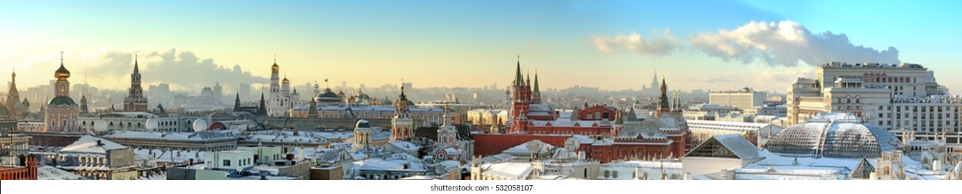 Moscow city historical skyline panorama winter snow building street kremlin tower red square university church cathedral government building hotel roof russian winter low sun theme aerial view