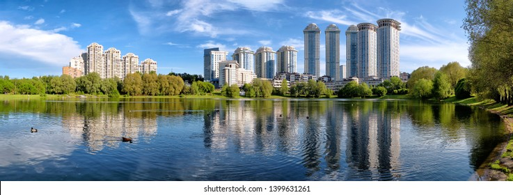 moscow city russia skyline modern residential building and park with duck pond urban street landscape panorama view of scenic cityscape and green forest reflection in lake water panoramic wide concept