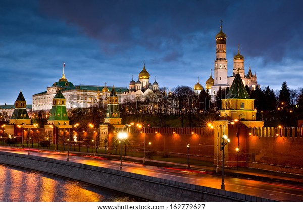 Moscow city. Scenic view of Moscow Kremlin illuminated. Night shot with Moskva river. Panorama view of  Moscow city, Russia. Postcard with Moscow view. Amazing picture of night Moscow