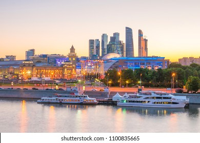 Moscow City skyline business district and Moscow River in Russia at sunset