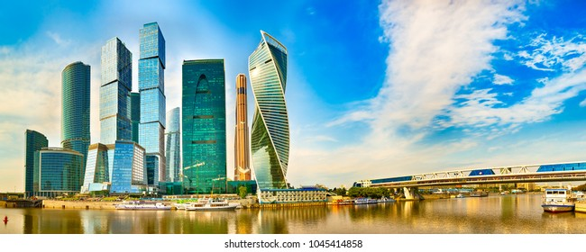 Moscow City skyline . Moscow International Business Centre at day time with Moskva river in foreground . Panorama