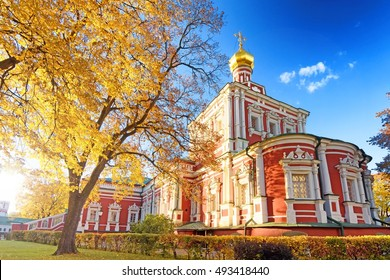 Moscow city skyline park street panorama view Uspenskaya church at Novodevichy convent golden domes against setting sun detail exterior panoramic travel autumn landmark religion theme scene lens flare