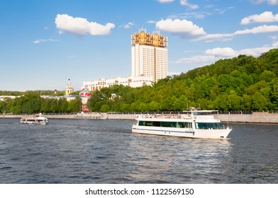 Moscow cityscape around Luzhnetskaya embankment along Moscow River people enjoy boat excursion in Moscow, Russia.