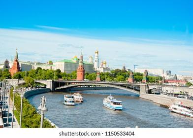 Moscow cityscape with Bolshoy Kamenny Bridge and Moscow Kremlin in the distance  around Moskvoretskaya Embankment, Russia.