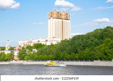 Moscow cityscape with modern Luzhnetskaya embankment along Moscow River people enjoy boat trip in Moscow, Russia.