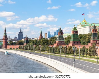 Moscow cityscape - view of Red Walls and Towers of Moscow Kremlin on Kremlin Embankment of Moskva Rive in Moscow, Russia in summer day