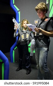 MOSCOW - DEC 13, 2014: Brother and sister in special vests with laser guns in laser tag at the shopping center Capitol Vernadsky