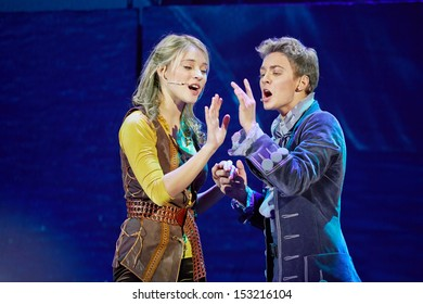 MOSCOW - DEC 15: Actors sing a duet in scene from musical spectacle for children Treasure Island on stage at Big Concert Hall Izmailovo, December 15, 2012, Moscow, Russia.