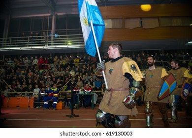 "MOSCOW - DECEMBER 03, 2016: Armored fignters different countries, knights, carry the flags at the opening of the XI World championship in Medieval combat CUP ""DYNAMO"". in the Olympic Center. Znamensky"