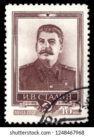 MOSCOW, December 1, 2018: CIRCA 1954: canceled postal stamp printed in USSR (Soviet Union) shows Joseph Stalin, famous soviet politician leader, 1st anniversary of the death, circa 1954.