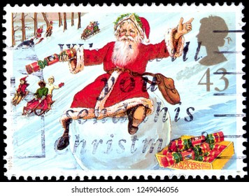 MOSCOW, December 1, 2018: CIRCA 1997: A stamp printed in Great Britain shows Father Christmas on Snowball, circa 1997