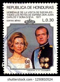 MOSCOW, December 1, 2018: Postage stamp printed in Honduras showing the portrait of Queen Sophia & King Juan Carlos, circa 1977
