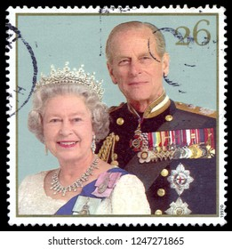 MOSCOW, December 1, 2018: stamp printed in United Kingdom showing Queen Elizabeth II and Duke of Edinburgh Prince Philip, celebrating the golden anniversary of the royal wedding, circa 1997