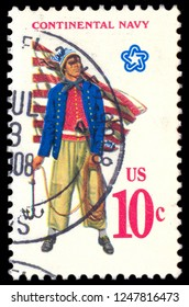 MOSCOW, December 1, 2018:  A stamp printed in United States of America shows Military uniform of the American Continental Navy. Sailor with grappling hook, First Navy Jack, circa 1970