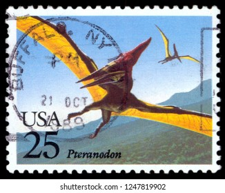"""MOSCOW, December 1, 2018: A stamp printed in USA from the """"Prehistoric Animals"""" issue shows Pteranodon, circa 1989."""