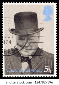 MOSCOW, December 1, 2018: A stamp printed in United Kingdom shows Sir Winston Spencer Churchill (1874-1965), with bowler and cigar, 1940, politician, circa 1974