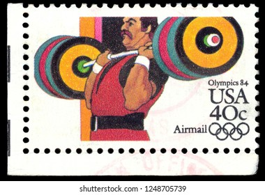 MOSCOW, December 1, 2018: A stamp printed in USA shows Weight Lifting, Olympic Games 1984 - Los Angeles serie, circa 1983