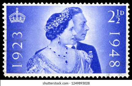 MOSCOW, December 1, 2018: A stamp printed in United Kingdom issued for the Royal Silver Wedding shows King George VI and Queen Elizabeth, circa 1948.