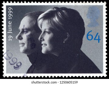 MOSCOW, December 1, 2018: A used postage stamp from the UK, commemorating the Royal Wedding date of Prince Edward and Sophie, circa 1999.