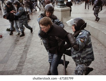 MOSCOW - DECEMBER 11: Police detain protesters during a rally in central Moscow December 11, 2010.  Thousands of people gathered near Kremlin to protest the shooting of a soccer fan Yegor Sviridov,
