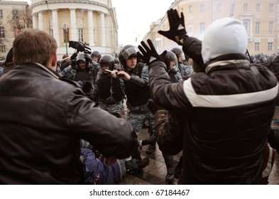 MOSCOW - DECEMBER 11: Riot police officers clash with protesters in central Moscow December 11, 2010.  Thousands of people gathered near Kremlin to protest the shooting of a soccer fan Yegor Sviridov,