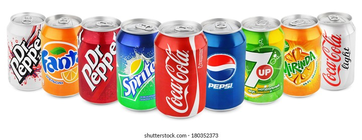 MOSCOW - DECEMBER 13, 2014: Group of various brands of soda drinks in aluminum cans isolated on white. Brands included in this group are Coca Cola, Pepsi, Sprite, Fanta, 7up, Mirinda, Dr Pepper