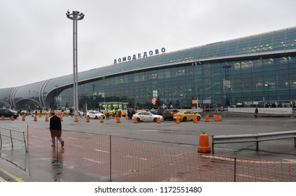 MOSCOW - DECEMBER 13, 2017: Domodedovo Airport with a taxi stand next to the airport building. Enclosure of the adjacent territory on which the road is being repaired