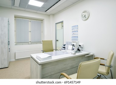 MOSCOW - DECEMBER 14, 2016: Modern interior of doctor's office in a clinic. Inside the clean and light doctor's office. Empty medical room.