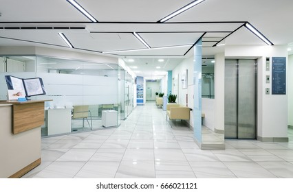 MOSCOW - DECEMBER 14, 2016: Panoramic view of a modern clinic interior. Panorama of a light entrance area inside the hospital. Empty bright floor with a hall in a new clinic.
