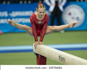 Moscow - December 16: Olga Sanjiyeva  competes on balance beam during International Tournament in Artistic Gymnastics Voronin Cup, in Moscow on December 16, 2014