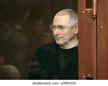 MOSCOW - DECEMBER 27:Jailed Russian former oil tycoon Mikhail Khodorkovsky stands behind the glass of the defendants' cage before the start of a court session December 27, 2010 in Moscow, Russia.