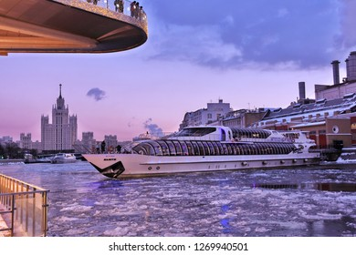 MOSCOW -  DECEMBER 29, 2018: A cruise yacht sails on the frozen Moscow river in the city center. River cruises are popular touristic entertainment. Color photo.