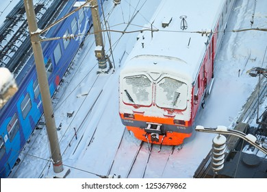MOSCOW, FEB. 01, 2018: Top view on red railway passenger train at rail way depot under snow. Snow covered passenger train in depot/ Trains in winter