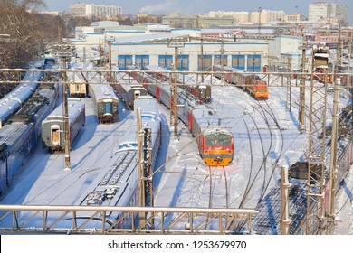 MOSCOW, FEB. 01, 2018: Winter view on railway passenger trains at rail way depot under snow. Snow covered Russian passenger trains, coaches in depot