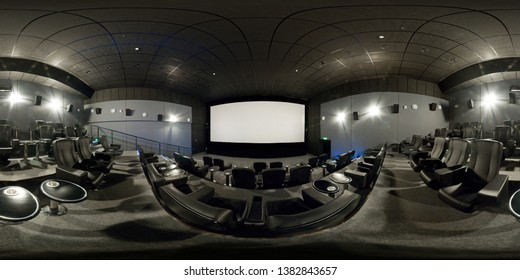 Moscow - Feb 10, 2012: 360 degrees full panorama of a modern cinema hall. 360 spherical view of movie theater interior with gray seats. Seamless panorama with equirectangular equidistant projection.