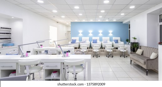 Moscow – Feb 7, 2019: Nail salon bright interior. Panoramic view of a modern manicure salon. Inside a beauty studio with white design.