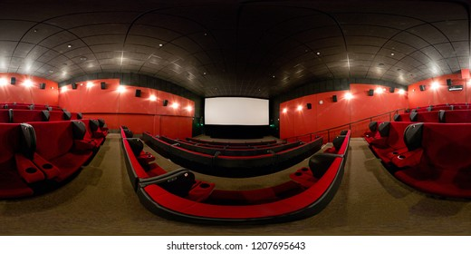 Moscow - Feb 9, 2012: 360 degrees full panorama of a modern cinema hall. 360 spherical view of movie theater interior with red seats. Seamless panorama with equirectangular equidistant projection.