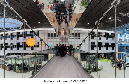 Moscow. February 15, 2017. Innovation Center Skolkovo. Excursion around Technopark. People stand on a pendant bridge admiring a beautiful view of the hall and pavilions.