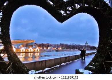 MOSCOW - FEBRUARY 24, 2019: View of Zaryadye park in Moscow, glass bridge. It is seen through the heart-shaped springtime decorations. Popular landmark.
