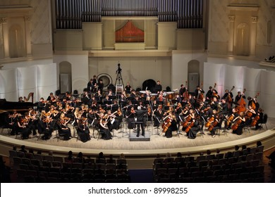 MOSCOW - FEBRUARY 26: Conductor Anatoly Levin directs Symphony Orchestra of Moscow State Conservatory named after P. Tchaikovsky in Tchaikovsky Concert Hall, on February 26, 2011 in Moscow, Russia.