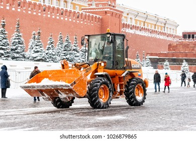 MOSCOW, FEBRUARY 5, 2018: Case wheeled loader works on Red Square of Moscow to remove snow after the snowstorm. The Case Corporation is the leading US manufacturer of construction equipment