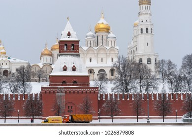 MOSCOW, FEBRUARY 5, 2018: DHL auto goes past the Kremlin in winter. DHL Express is the division of the German logistics company Deutsche Post, provides international express mail services