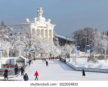 Moscow - February 6, 2018: Many happy people in winter clothes are skating on the largest skating rink in the historic amusement park at VDNKh in winter February 6, 2018, Moscow, Russia