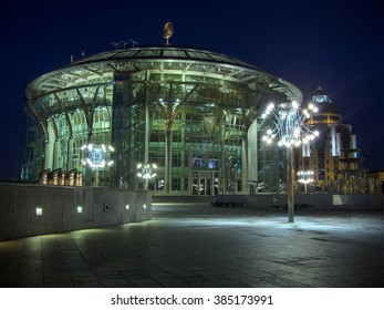 Moscow House of Music (International Performing Arts Center) at night. Peaceful scene with modern circular glass building and street lamps on foreground. High dynamic range photo (5 exposures).