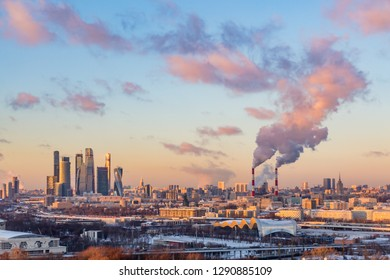 """Moscow international business center """"Moscow-city"""". Smoke from the pipes of the combined heat and power plant. Winter evening cityscape."""